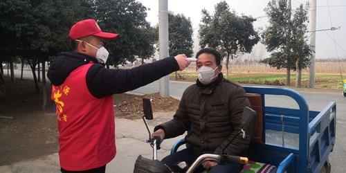 图为示范区残联党员志愿者支援基层疫情防控工作现场三