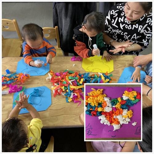 图为孩子一起制作中国地图装饰画